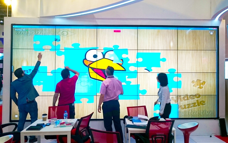 Touchscreen apps on giant video wall by ZaagTech